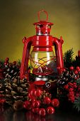 stock photo of kerosene lamp  - Red kerosene lamp on dark color background - JPG