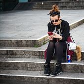 STUTTGART, GERMANY - APRIL 01, 2014: Unidentified young woman rests in a Park - near the Central squ