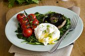 stock photo of portobello mushroom  - Poached egg with spinach Portobello mushroom and vine tomatoes - JPG