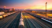 stock photo of railroad yard  - Cargo freigt train railroad station at dusk - JPG