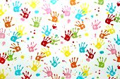 image of mural  - Colorful children hand print on a wall - JPG