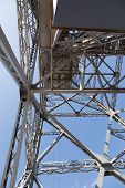 stock photo of ropeway  - Metal designs of a tower of a ropeway in Barcelona - JPG