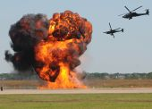 stock photo of attack helicopter  - Two military helicopter attacking target on the ground - JPG
