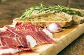 Постер, плакат: Spanish Ham With Toasts Focus On Garlic