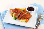 image of duck breast  - Roasted duck breast with vegetables and cutlery top view - JPG