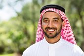 close up portrait of happy arabian man outdoors