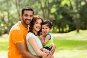 foto of indian beautiful people  - beautiful young indian family outdoors looking at the camera - JPG