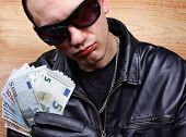 stock photo of thug  - Chief boss mafia gangster thug with stolen money euro - JPG