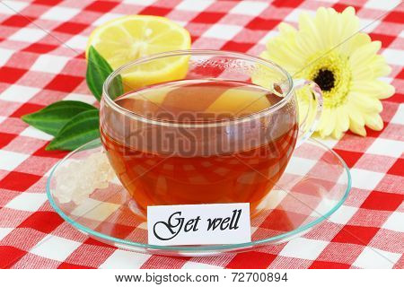 Get well card with cup of tea, lemon and cream gerbera