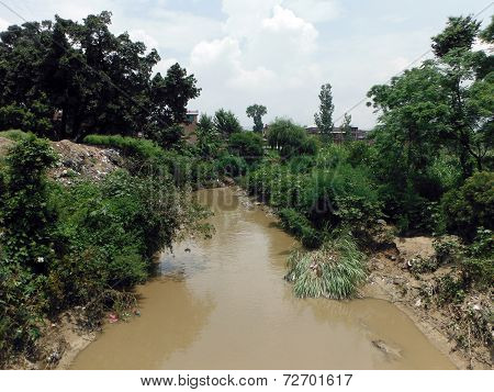 Monsoon-grown Muddy Rural River In The Ancient City Bhaktapur