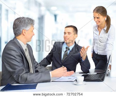 A business team sitting in office