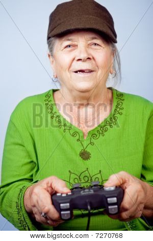 Happy Senior Woman Playing Video Games