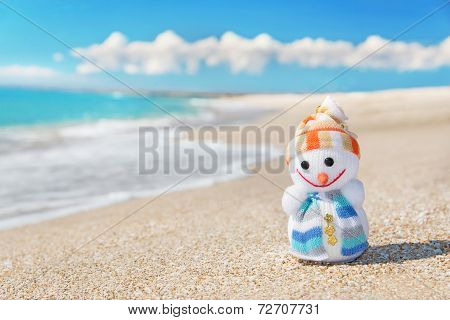 Smiley Toy Christmas Snowman At Hot Sea Beach.