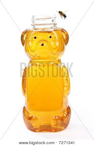 Honey In Bear Bottle With A Flying Bee