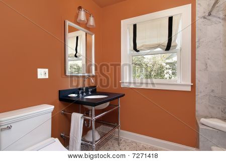 Powder Room With Orange Walls