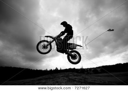 Dirt Bike Jumping Sand Dunes - Sihlouette