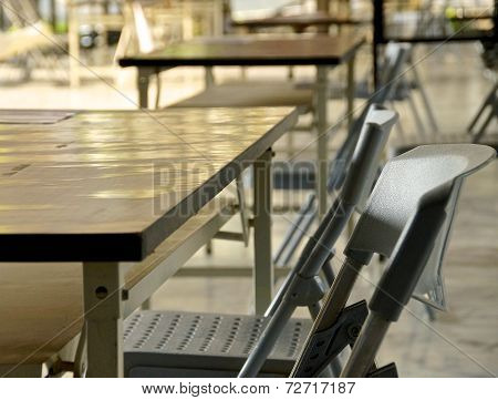Empty chairs on outdoor classroom