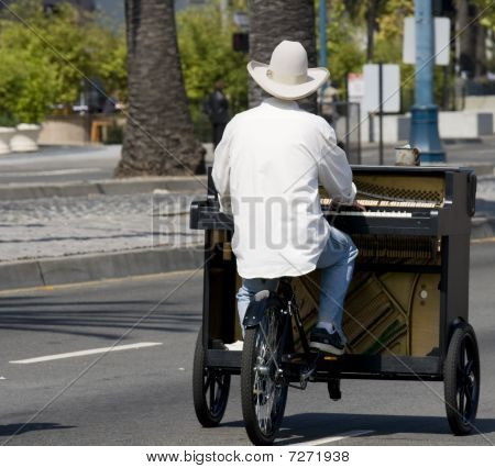 Guy On Piano Bike
