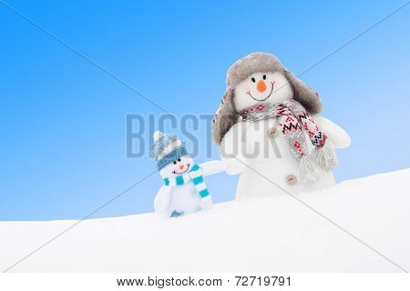 Happy Winter Snowmen Family Or Friends Against Blue Sky