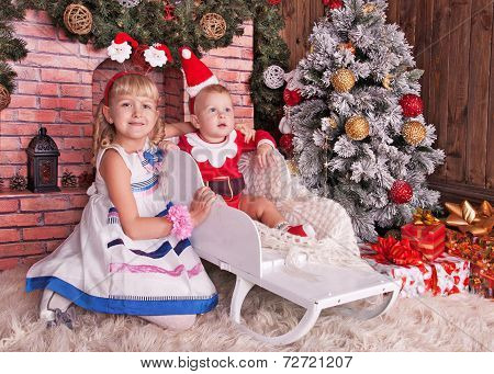 Happy Children With Christmas Gift Box Near Christmas Tree