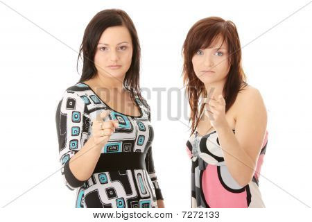 Two Young Womans Pointing
