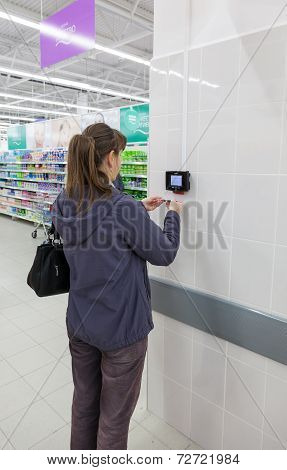 Young Woman Checks The Value Of The Goods On The Barcode