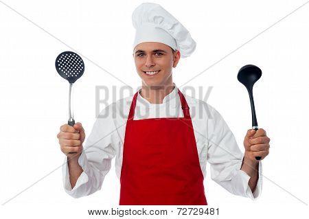 Male Chef Holding Kitchen Essentials