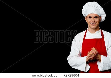 Young Male Chef Posing In Uniform