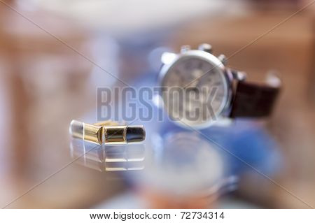 Cufflinks And Wristwatch