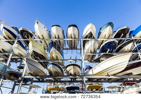 Speed Motor Boats Are Stapled In A Garage System In The Prestigious Harbor