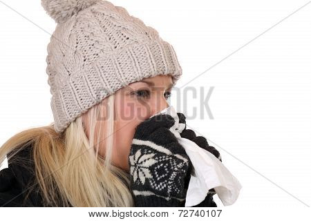 Young Woman With A Cold And Flu Virus Sneezing Into A Tissue Is Ill