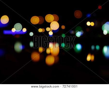 Blurred city at night background. Nightcity street lights bokeh wallpaper.