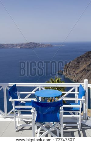 Table on terrace overlooking sea