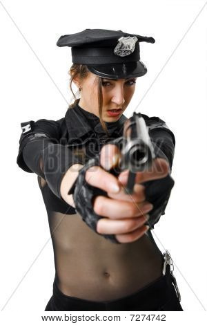 beautiful policewoman aiming a gun