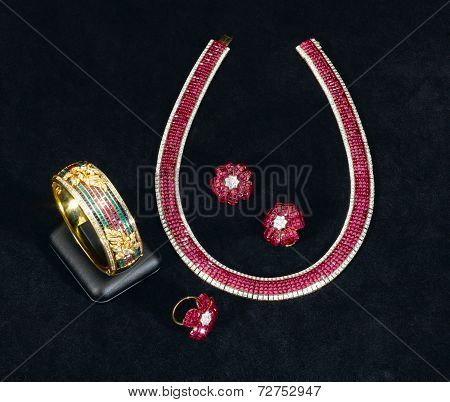 the Siam ruby bracelet, necklace, ring and earrings