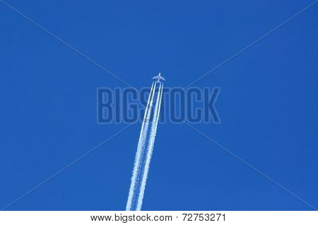Emirates Airbus A380 with contrails.