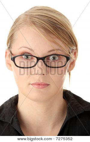 Portrait Of A Pretty Young Woman In Glasses