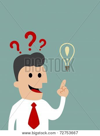 Businessman pointing toward a light bulb