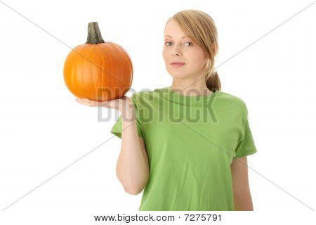 Young Woman Holding Orange Pumpkin