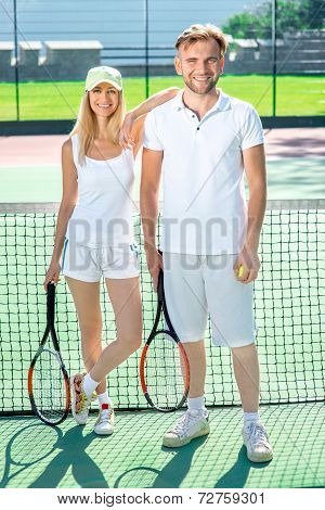 Young couple playing tennis