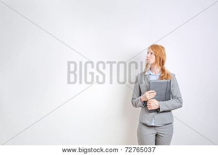 Businesswoman Before A Large White Wall