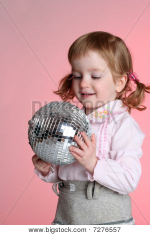 Little Girl With Mirror Sphere Isolated On Pink Background