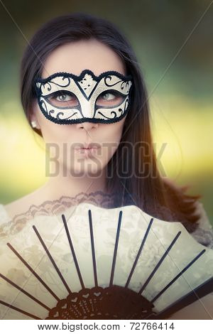 Surprised Young Woman with Mask and Fan