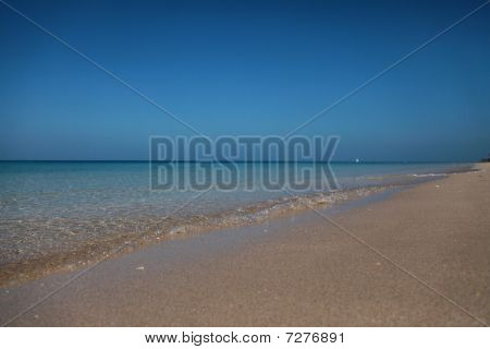 Delicate Sand Shore Washed By Clear Waves