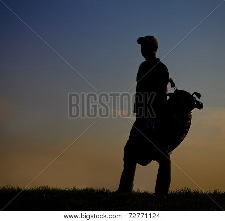 Male Golfer At Sunset