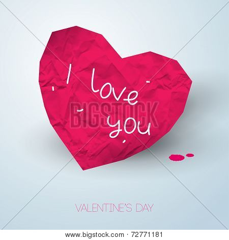 Paper pink heart with handwritten message on light backdrop with