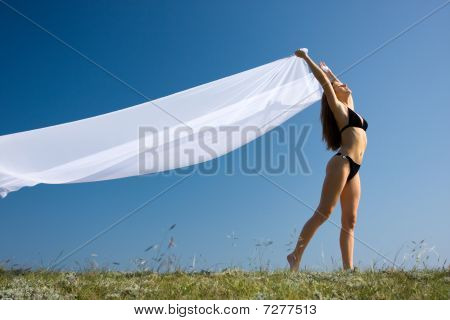 Woman With White Material And Nature