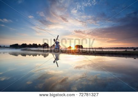 Sunrise Over Dutch Windmill And River