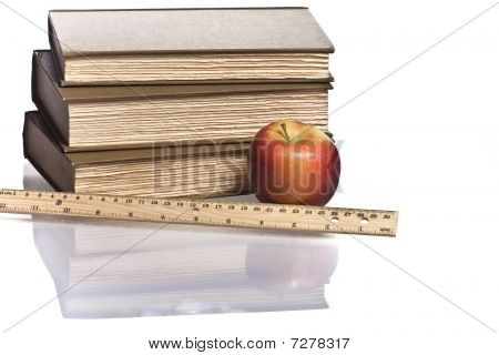 wooden ruler red apple three books