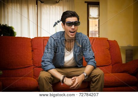 Young Man Wearing 3D Glasses Reacting In Surprise